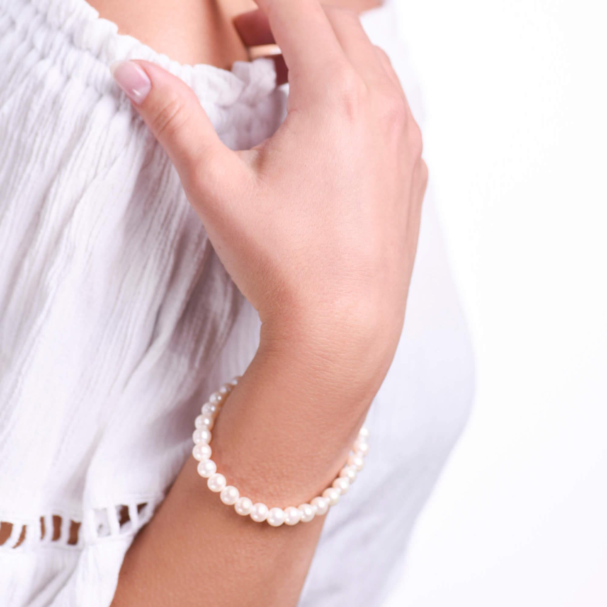 Damsky-perlovy-naramek-bile-sladkovodni-perly-AAA-bile-zlato-ruka.jpg